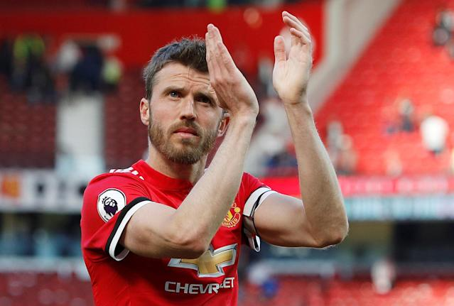 "Soccer Football - Premier League - Manchester United vs Watford - Old Trafford, Manchester, Britain - May 13, 2018 Manchester United's Michael Carrick applauds the crowd after the match REUTERS/Darren Staples EDITORIAL USE ONLY. No use with unauthorized audio, video, data, fixture lists, club/league logos or ""live"" services. Online in-match use limited to 75 images, no video emulation. No use in betting, games or single club/league/player publications. Please contact your account representative for further details."