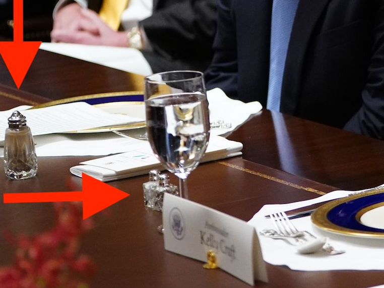 US President Donald Trump listens as US Representative to the UN Kelly Craft speaks during a luncheon with the UN Security Council permanent representatives in the Cabinet Room of the White House in Washington, DC, on December 5, 2019.