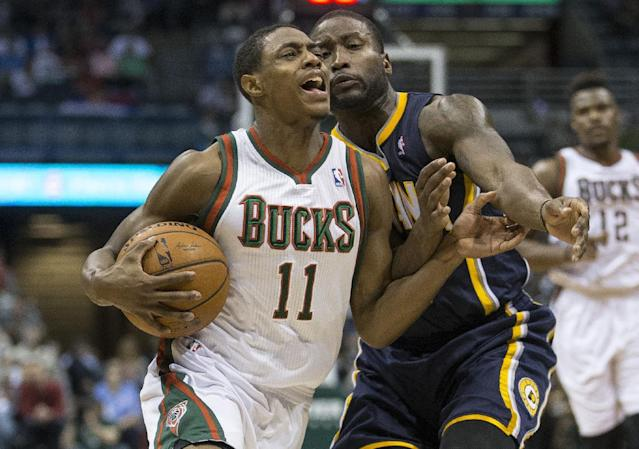 Milwaukee Bucks' Brandon Knight (11) drives against Indiana Pacers' Donald Sloan during the first half of an NBA basketball game on Wednesday, April 9, 2014, in Milwaukee. (AP Photo/Tom Lynn)