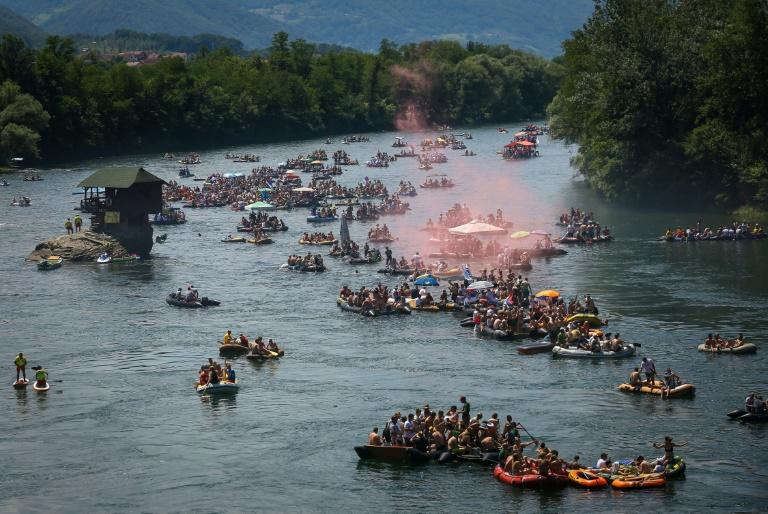Hundreds of inflatable dinghies, makeshift rafts, lorry inner-tubes, even giant inflatable flamingos and the occasional boat float and row for hours on the Drina river (AFP Photo/OLIVER BUNIC)