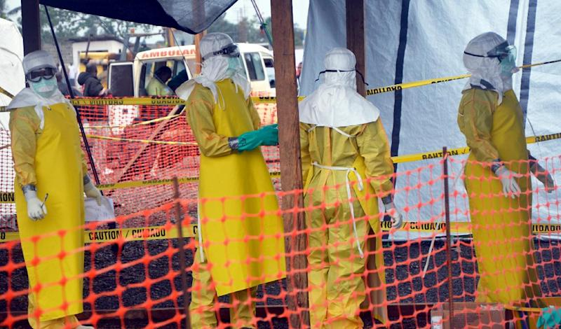 French NGO Doctors Without Borders (MSF) staff members stand in protective gear at the MSF ELWA hospital in Monrovia, where patients suffering from Ebola are treated