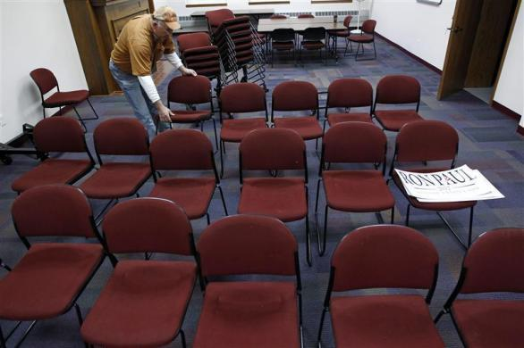 A supporter of Ron Paul sets up a room to be used for a Town Hall meeting at the Ericson Public Library during a campaign stop in Boone, Iowa, December 8, 2011. (REUTERS/Jim Young)