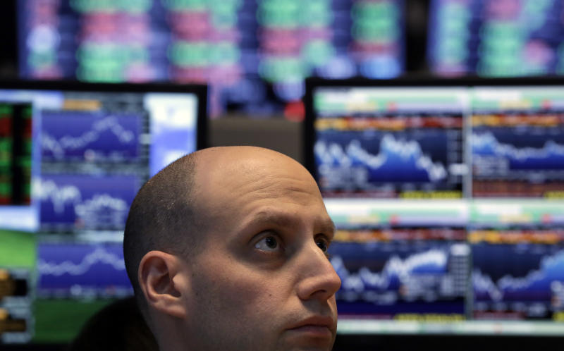 Specialist Meric Greenbaum works at his post on the floor of the New York Stock Exchange Thursday, Feb. 28, 2013. The stock market pushed higher Thursday afternoon, sending the Dow tantalizingly close to a record high. (AP Photo/Richard Drew)