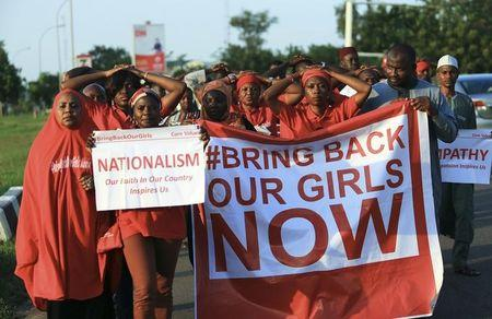 """#Bring Back Our Girls"" campaigners participate in a lamentation parade, as more towns in Nigeria come under attack from Boko Haram in Abuja, November 3, 2014. REUTERS/Afolabi Sotunde/Files"