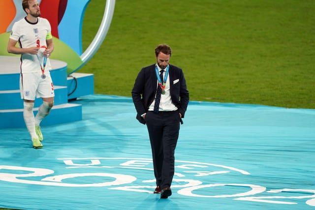 England manager Gareth Southgate and Harry Kane leave the presentation podium disappointed