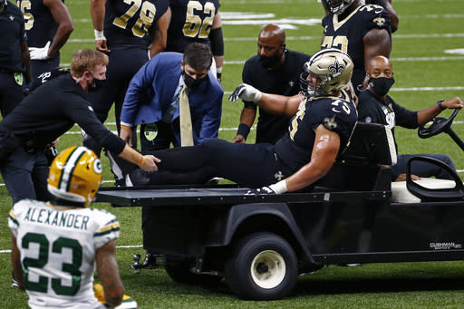 Saints' Peat injures ankle, Packers' Kirksey hurts shoulder