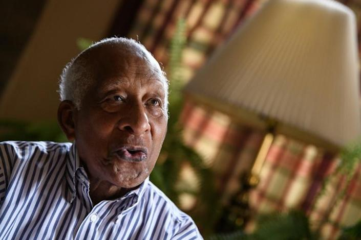 Dan Smith, 88, represents a living link to the nation's dark past: his father Abram was born a slave, 157 years ago