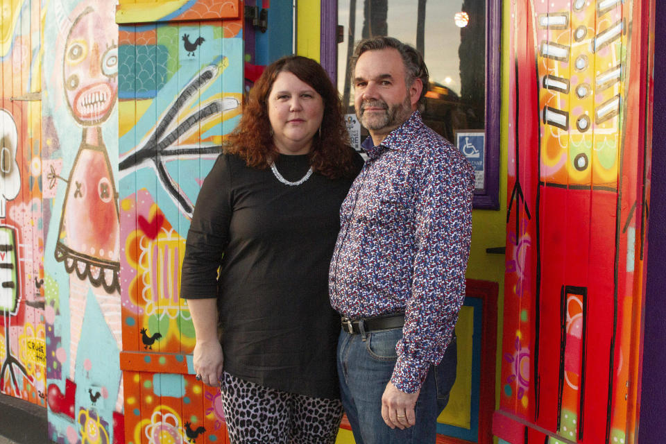 Jennifer and Matt Johnson pose for a portrait in New Orleans, Friday, Jan. 29, 2021. They bought what is now the Carnaval Lounge on St. Claude in summer 2019, and the 2020 Mardi Gras season was their first as business owners. The lounge was becoming popular for live music and Brazilian food. (AP Photo/Dorthy Ray)