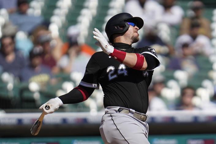 Chicago White Sox's Yasmani Grandal hits a solo home run against the Detroit Tigers in the fourth inning of a baseball game in Detroit, Monday, Sept. 27, 2021. (AP Photo/Paul Sancya)