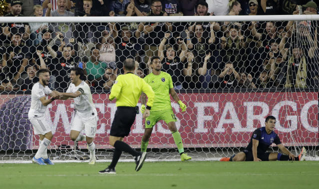 Los Angeles FC forward Carlos Vela, second from left, celebrates with forward Diego Rossi, left, after scoring past San Jose Earthquakes goalkeeper Daniel Vega, center, and defender Nick Lima, right, during the first half of an MLS soccer match Wednesday, Aug. 21, 2019, in Los Angeles. (AP Photo/Marcio Jose Sanchez)
