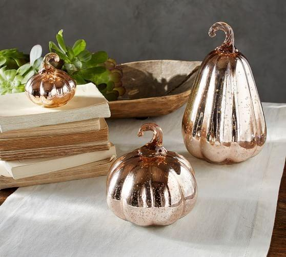 <p>The antique rose gold finish on these <span>Mercury Glass Pumpkins </span> ($11-$30) create an enchanting display.</p>