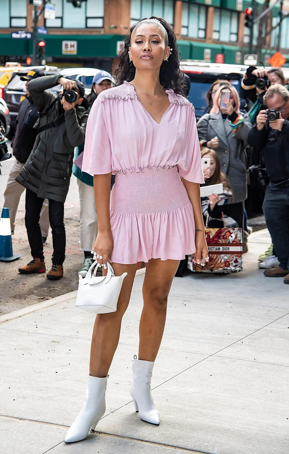 <p>In 2017, Leyna Bloom was one of the few openly transgender models walking the runways at Fashion Week and she is an activist for the LGBTQIA+ and Black communities. As the second trans model to be featured in <b>SI Swim</b>, alongside Valentina, she also made history as the first Black and Asian trans woman in the iconic magazine.</p>