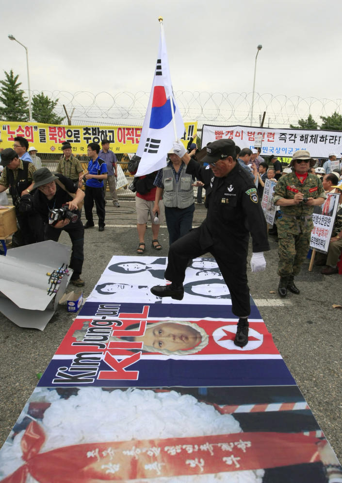 An anti-North Korean protester stomps on a picture of North Korean leader Kim Jong Un during a rally denouncing pro-North Korean activist No Su-hui near the border village of Panmunjom, in Paju, South Korea, Thursday, July 5, 2012. South Korean police arrested No for making an extended trip to Pyongyang without government approval. (AP Photo/Lee Jin-man)