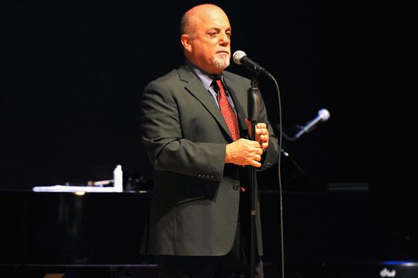 Billy Joel Surprises With Two Songs at High School Graduation