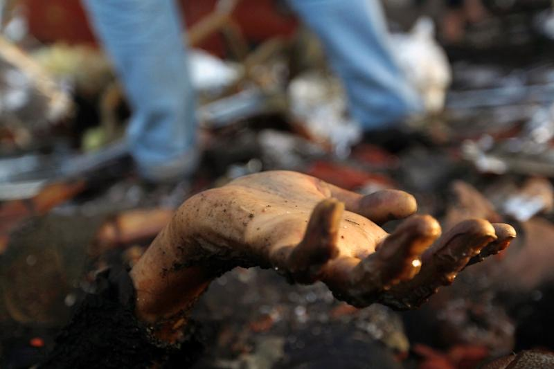 The hand of a victim amid the destruction following reported airstrikes by Saudi-led coalition air-planes on the capital Sanaa (AFP Photo/Mohammed Huwais)