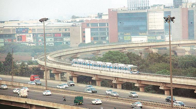 rapid metro to dmrc, rapid metro gurgaon, delhi metro, delhi city news, indian express news