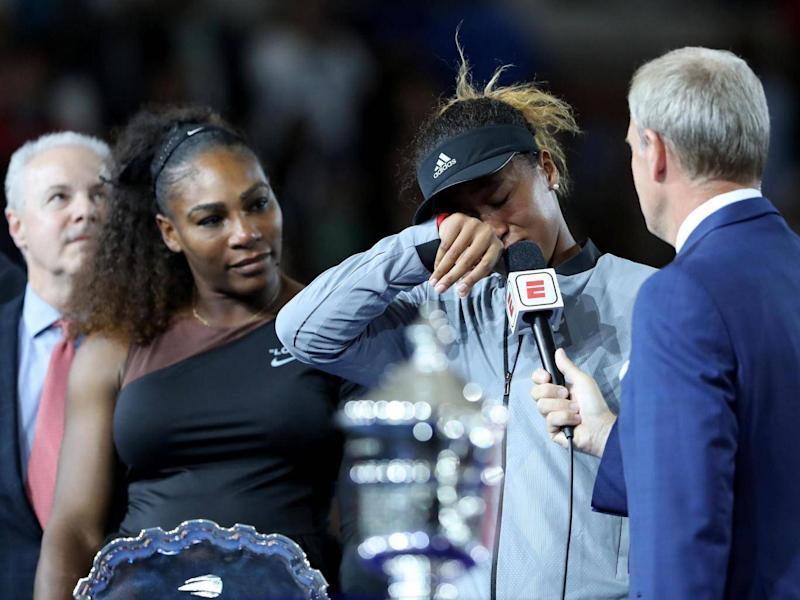Emotions got the better of Osaka as she was presented with her trophy (Getty)