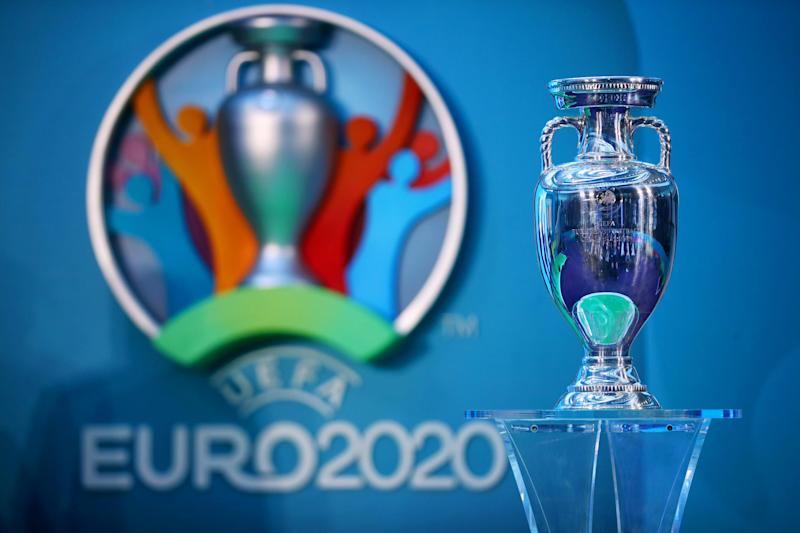 The European Championship trophy next to the logo for Euro 2020: Getty Images