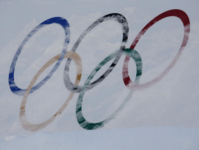 Olympic rings are covered with fresh snow at the Phoenix Snow Park in PyeongChang, South Korea. (AP)