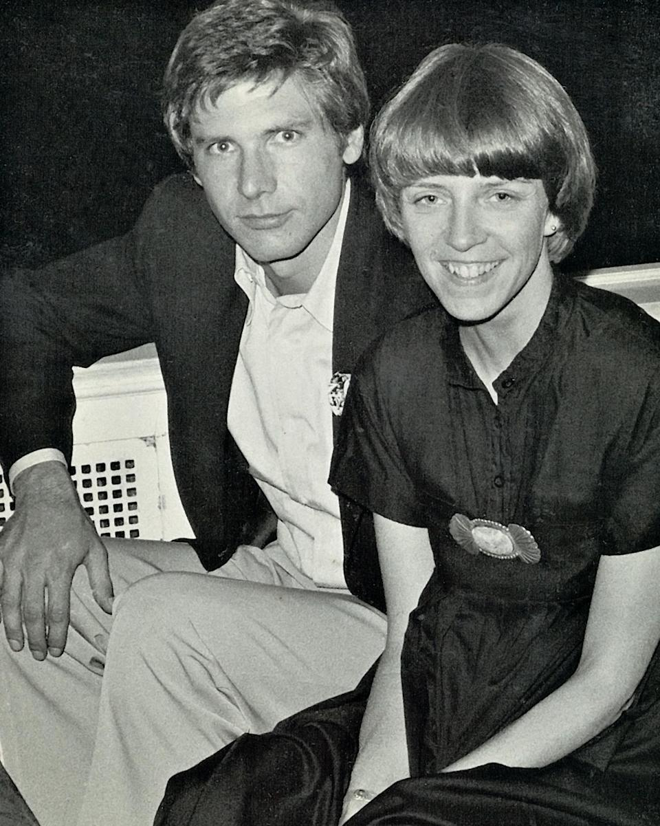 """<p>Harrison Ford lounged next to his then-wife Mary Marquardt at the <em>Star Wars</em> party. In the book, he writes about how close he became with the McGraths. """"He is the godfather of at least two of my children, though he claimed slightly more, as Earl would,"""" Ford writes. </p>"""