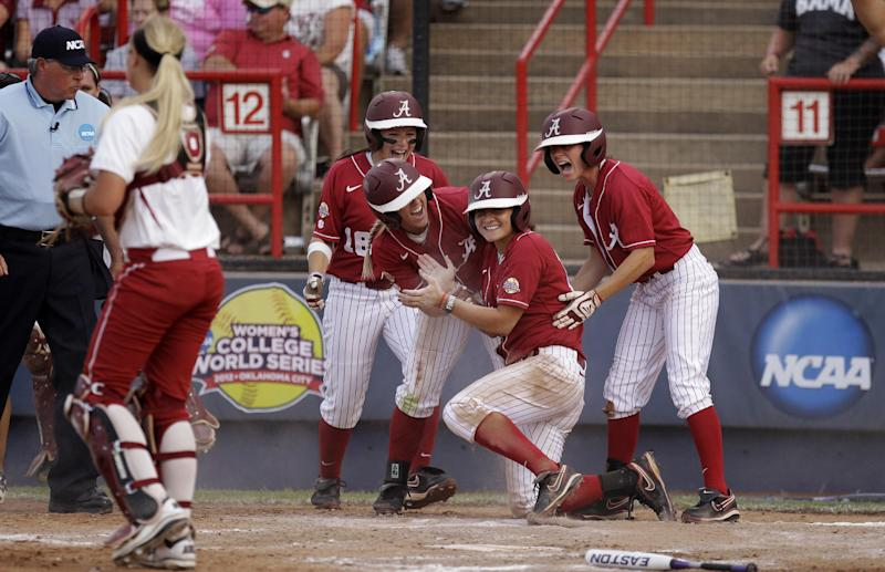 Alabama's Cassie Reilly-Boccia (18), Jazlyn Lunceford, Kaila Hunt and Jennifer Fenton, from left, celebrate after Hunt scored behind Oklahoma catcher Jessica Shults, left, in the second inning of the second game of the NCAA Women's College World Series softball finals in Oklahoma City, Tuesday, June 5, 2012. (AP Photo/Sue Ogrocki)