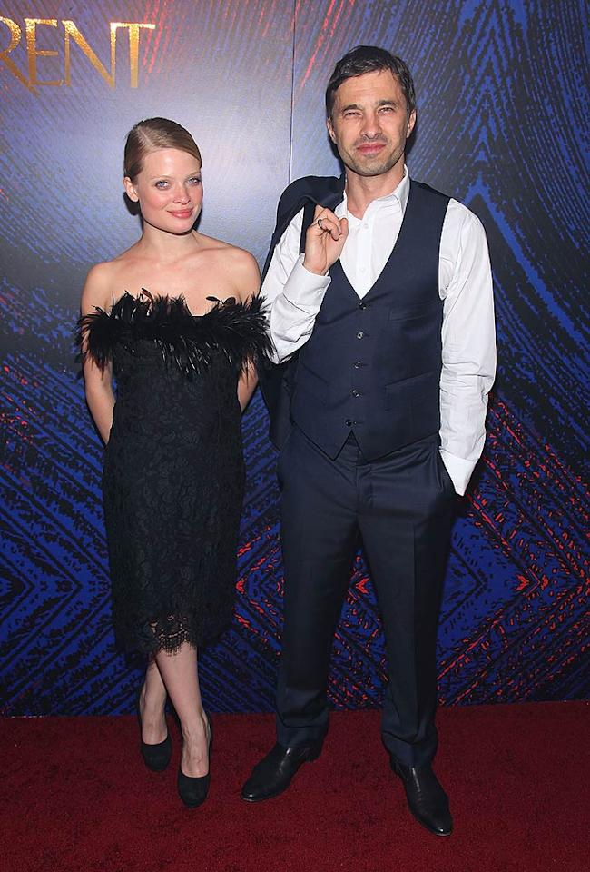 """Sporting a black, feathered number, """"Babylon A.D."""" actress Melanie Thierry hit the red carpet with a very hunky Olivier Martinez. Mike Coppola/<a href=""""http://www.wireimage.com"""" target=""""new"""">WireImage.com</a> - June 17, 2010"""