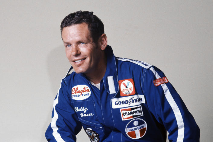 """FILE - Race car driver Bobby Unser is shown in this 1977 file photo. Bobby Unser, a three-time Indianapolis 500 winner and part of the only pair of brothers to win """"The Greatest Spectacle in Racing"""" has died. He was 87. He died Sunday, May 2, 2021, at his home in Albuquerque, New Mexico of natural causes, The Indianapolis Speedway said Monday. (AP Photo/File)"""