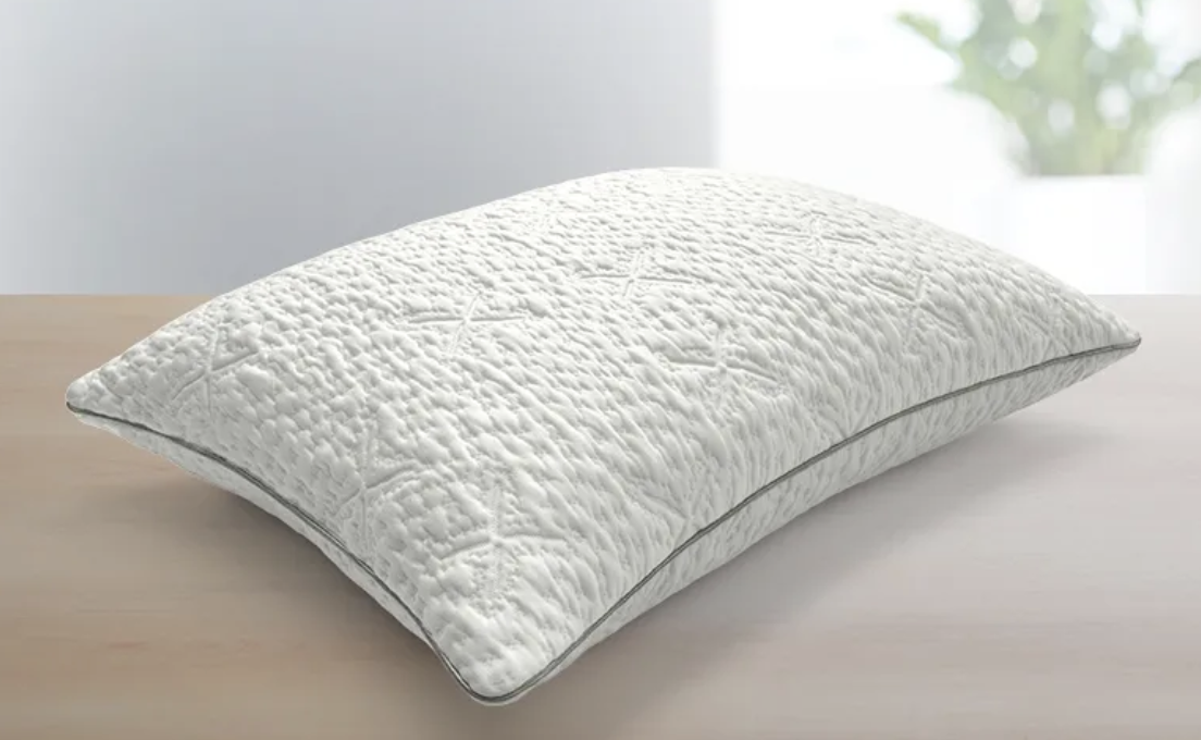 The curved Sleep Number ComfortFit pillow is the simplest yet still divine option in this sale. (Photo: Sleep Number)