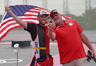 <p>Team USA's gold medalist Vincent Hancock takes a selfie with his coach following his Skeet Men's Finals win at the Asaka Shooting Range on July 26.</p>