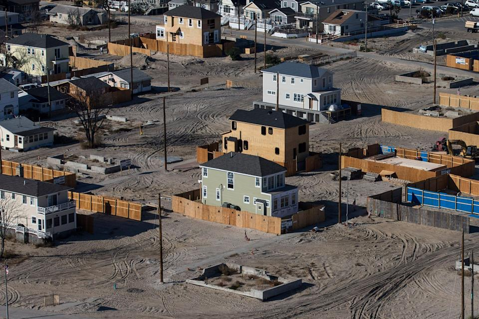 Homes sit under construction one year after being destroyed by Superstorm Sandy in the Breezy Point neighborhood of Queens, New York City. (Photo: Andrew Burton via Getty Images)
