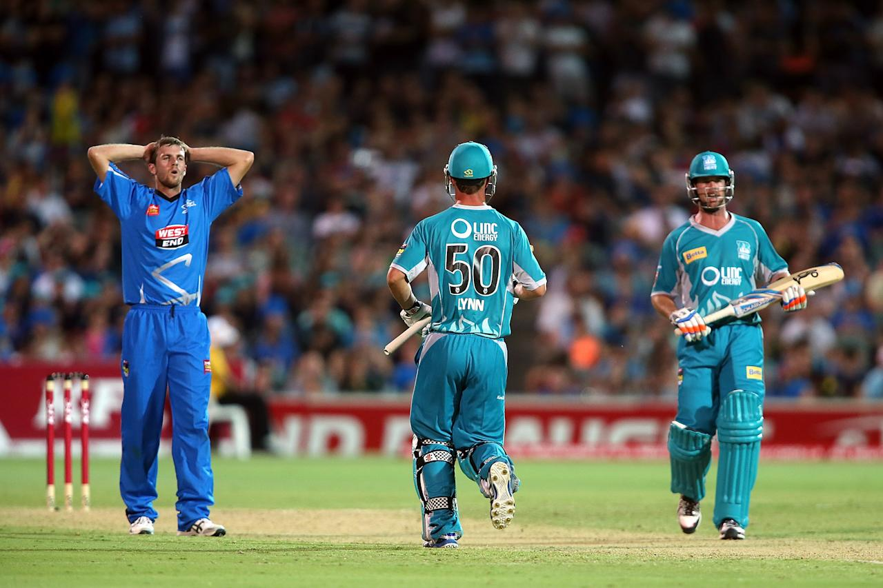 ADELAIDE, AUSTRALIA - DECEMBER 13: Gary Putland (L) of the Stirkers reacts as runs is scored from his bowling during the Big Bash League match between the Adelaide Strikers and the Brisbane Heat at Adelaide Oval on December 13, 2012 in Adelaide, Australia.  (Photo by Morne de Klerk/Getty Images)