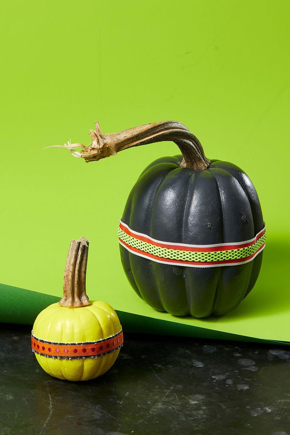"<p>Adding personality to your pumpkins can be as simple as cutting some ribbon. Start by painting your pumpkin (or leave it natural for a more rustic look). Then, cut a length of ribbon or trim to fit the width of a pumpkin. To finish, just attach it with a few drops of hot glue. If you're feeling creative, layer ribbons and trim for an even more custom look.</p><p><a class=""link rapid-noclick-resp"" href=""https://www.amazon.com/Burlap-Ribbon-White-Lace-Ribbons/dp/B074QR9JCD/?tag=syn-yahoo-20&ascsubtag=%5Bartid%7C10055.g.1714%5Bsrc%7Cyahoo-us"" rel=""nofollow noopener"" target=""_blank"" data-ylk=""slk:SHOP RIBBON"">SHOP RIBBON </a></p>"