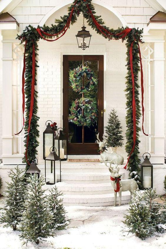 "<p><a href=""http://bygeorgiagrace.com/2018/12/decorating-for-christmas-with-natural-garland-wreaths/"" rel=""nofollow noopener"" target=""_blank"" data-ylk=""slk:By Georgia Grace"" class=""link rapid-noclick-resp"">By Georgia Grace</a> got extra-festive with her theme by having not one but two wreaths on her door. Use garlands as well to mix and match different types of greenery outside.</p>"