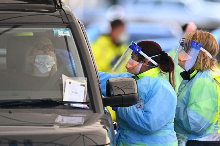 Health workers test people for Covid-19 at a drive-through clinic at Bondi Beach in Sydney