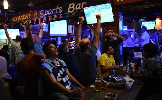 Fans in Manila react as they watch the World Cup match between France and Argentina in a bar (AFP Photo/TED ALJIBE)