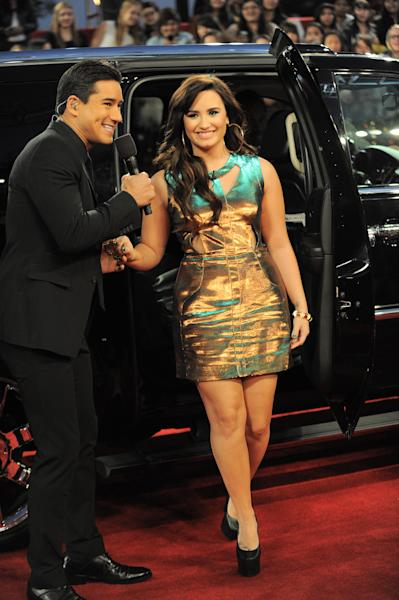 """Demi Lovato arrives at the """"The X Factor"""" season finale results show at CBS Television City on Thursday, Dec. 20, 2012, in Los Angeles. (Photo by Jordan Strauss/Invision/AP)"""