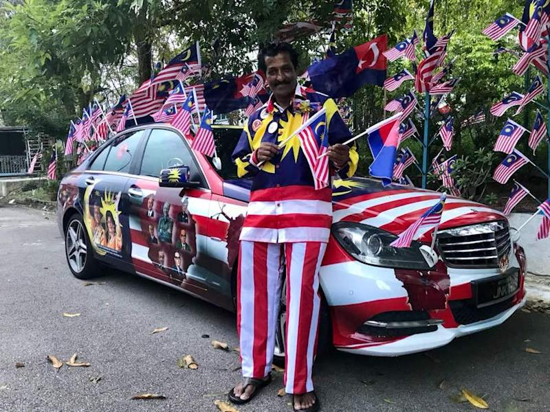 Businessman M. Kandapan poses with his Merdeka-themed Mercedes-Benz outside his home in Bandar Seri Alam in Masai. — Picture by Ben Tan