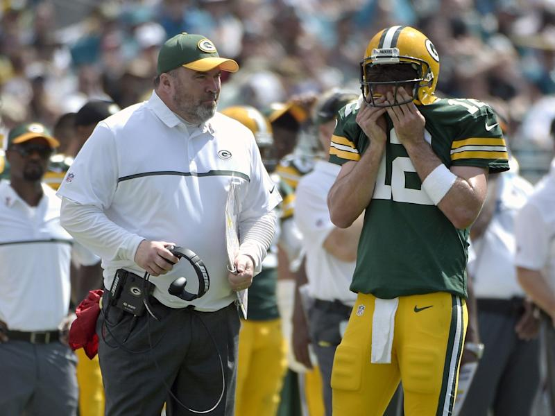 FILE - In this Sept. 11, 2016, file photo, Green Bay Packers head coach Mike McCarthy and quarterback Aaron Rodgers (12) chat on the sideline during the second half of an NFL football game against the Jacksonville Jaguars in Jacksonville, Fla. McCarthy is confident that Rodgers and Green Bay's struggling offense will get better. Two games into the season, the results have been uncharacteristically ugly. (AP Photo/Phelan M. Ebenhack, File)