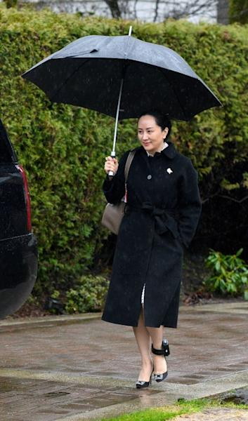 Huawei Chief Financial Officer Meng Wanzhou leaves her home to attend her extradition hearing in Vancouver