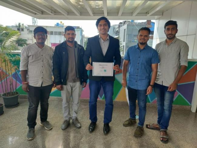 Gautham Pasupuleti (center) and the Biodesign Innovation Labs engineering team following their win