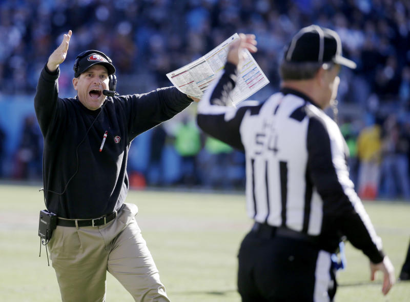 San Francisco 49ers head coach Jim Harbaugh reacts to a a call at the end of the first half against the Carolina Panthers during the first half of a divisional playoff NFL football game, Sunday, Jan. 12, 2014, in Charlotte, N.C. (AP Photo/John Bazemore)