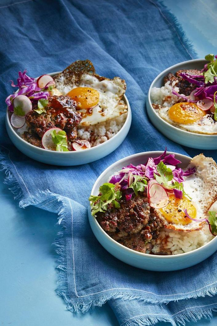 """<p>Hungry? Top your rice bowl with a ginger-scallion sausage patty.</p><p><em><a href=""""https://www.womansday.com/food-recipes/food-drinks/a16758962/sticky-rice-bowl-recipe/"""" rel=""""nofollow noopener"""" target=""""_blank"""" data-ylk=""""slk:Get the recipe from Woman's Day »"""" class=""""link rapid-noclick-resp"""">Get the recipe from Woman's Day »</a></em></p>"""