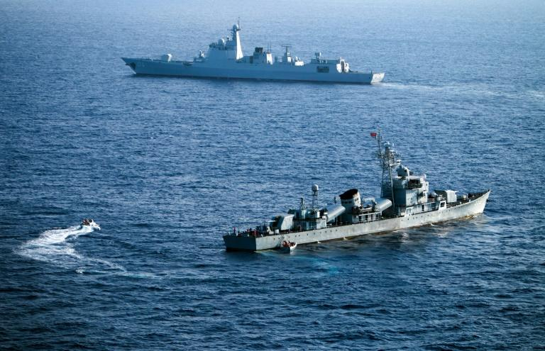Chinese naval vessels in exercises in 2016 in the contested Paracel islands in the South China Sea - a US Navy ship sailed in the area to assert freedom of navigation rights