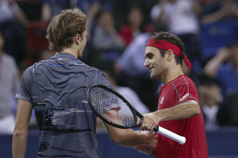 Alexander Zverev of Germany is greeted by Roger Federer of Switzerland after winning in the men's singles quarterfinals match at the Shanghai Masters tennis tournament at Qizhong Forest Sports City Tennis Center in Shanghai, China, Friday, Oct. 11, 2019. (AP Photo/Andy Wong)