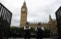 FILE PHOTO: Police officers stand guard in front of Big Ben at the entrance to the Palace of Westminster in London, Britain, June 8, 2017. REUTERS/Marko Djurica/File Photo