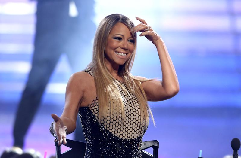 "FILE - This May 16, 2013 file photo shows Mariah Carey at the ""American Idol"" finale at the Nokia Theatre at L.A. Live  in Los Angeles. Carey says she isn't retuning to ""American Idol."" The pop star's publicity firm, PMK BNC, tweeted Thursday that Carey isn't returning to the Fox series and is planning a world tour thanks to the success of her new single, ""Beautiful.""  (Photo by Matt Sayles/Invision/AP, file)"
