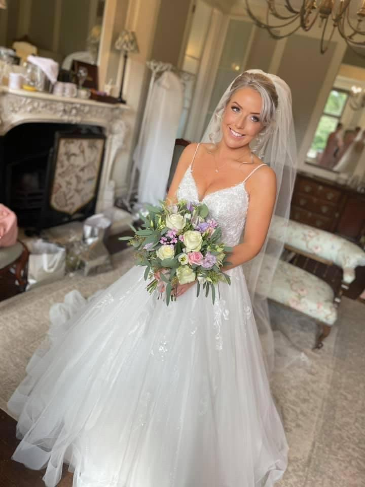 Lydia Evans-Hughes, 29, was given a lift to the church by a kind-hearted police officer after the vintage car she was travelling to her wedding in broke down (swns)