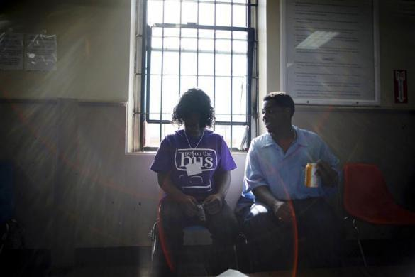 Dejane (L), 14, sits with her father Jonathan at San Quentin state prison in San Quentin, California June 8, 2012.