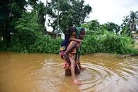 NAGAON,INDIA-JULY 22,2020 :Girls wade through flood water at a flood-affected village in Nagaon district of Assam,India - PHOTOGRAPH BY Anuwar Ali Hazarika / Barcroft Studios / Future Publishing (Photo credit should read Anuwar Ali Hazarika/Barcroft Media via Getty Images)