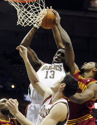 Milwaukee Bucks' Ekpe Udoh (13) grabs a rebound against the Cleveland Cavaliers during the first half of an NBA basketball game, Wednesday, April 4, 2012, in Milwaukee. (AP Photo/Jeffrey Phelps)